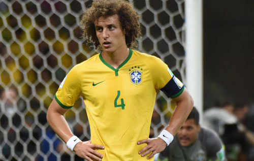 Desolation: David Luiz tries to get his head around Brazil's 7-1 hammering and his own personal disaster. *AFP Photo